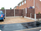 Concrete with 5ft waney lap fence panels and 2ft waneylap fence panels.