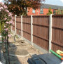 Feather edge AKA close board or vertilap fence panels.