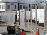 Making preparations to erect commercial fencing at a site in Trafford Park Manchester.