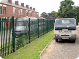 2 metre powder coated steel palisade fencing fitted to the perimiter of a church in Bolton.