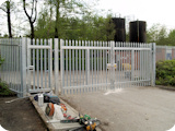2.4 metre industrial steel palisade double gates with pedestrian gate fitted to secure one of our defence contracts clients premesis in Middleton Manchester.