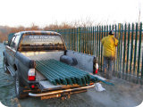 Bury Fencing installing 2 metre powder coated palisade fencing around a sports field perimiter in Bury.