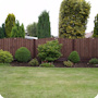 PVC plastic fence posts and bases with 2ft arch-top feather edge fence panels.