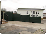 Complete PVC fencing system with arched tops.