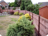 PVC fencing with 3ft waney lap wood fence panels.