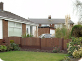 2ft arch top feather edge fence panels with brown PVC fence system.