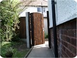 Feather edge wooden double gates.