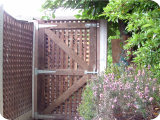 5ft standard guage trellis panels in concrete posts and on concrete bases.