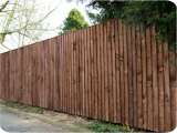 Close board feather edge post and rail fencing at a garden in Edenfield.