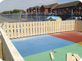 Softwood smooth finish wooden fencing for a nursery playgroung at Deane in Bolton.