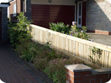 Tanalised feather edge close board fencing tapered from 3ft to 2ft