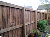 Post and rail feather edge closeboard bespoke wooden fencing dividing gardens in Horwich.