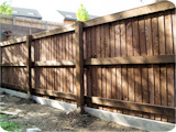 Post and rail wooden vertical lap feather edge fencing. AKA close board fencing at a garden in Bolton.