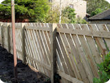 Diagonally paled post and rail timber garden fencing at gardens in Edgworth Bolton.