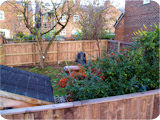Wooden closeboard fencing custom built on site in Stockport.